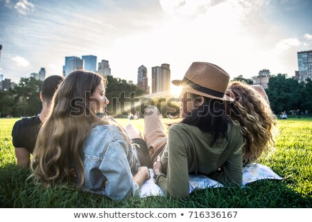 four friends lying in the grass Stock photo © photography33
