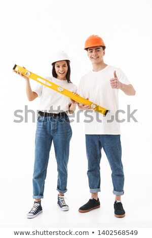 a male carpenter holding a couple of planks stock photo © photography33
