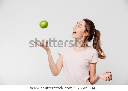 young beautiful happy woman holding green apple on white stock photo © artjazz