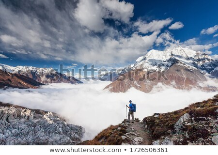 Climber on the summit. stock photo © gregepperson