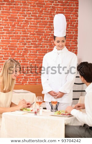 Couple complimenting the chef on her cooking Stock photo © photography33