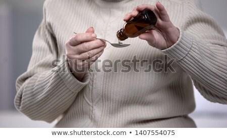 Idős nő elvesz köhögés szirup egészség Stock fotó © photography33