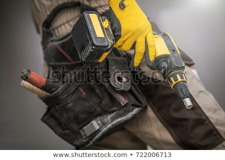 gloved hand with drill stock photo © gekaskr
