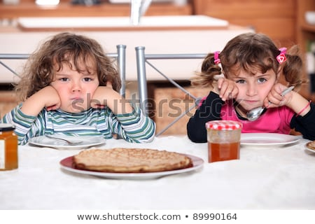grumpy children at a table with pancakes stock photo © photography33