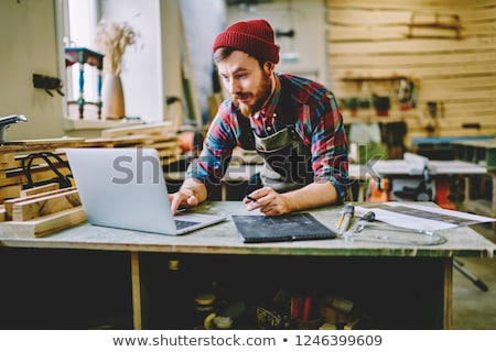 Carpenter with a laptop Stock photo © photography33