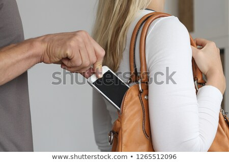 блондинка кошелька КПК довольно женщину модель Сток-фото © acidgrey