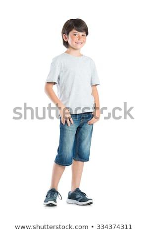 nieśmiała · chłopca · stwarzające · biały · uśmiech · twarz - zdjęcia stock © wavebreak_media