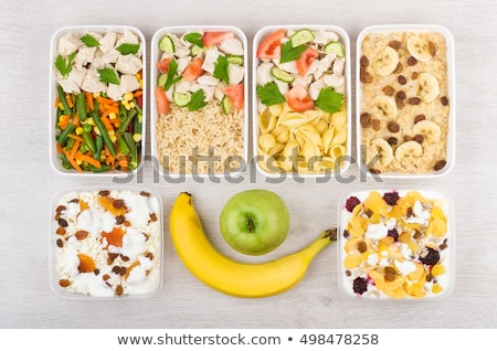 cheese in plastic container with raisins Stock photo © ozaiachin