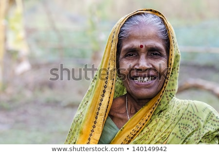 Middle age indian villager woman smiling Stock photo © ziprashantzi