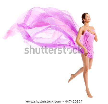 Beautiful woman in  waving fabric. Stock photo © fanfo