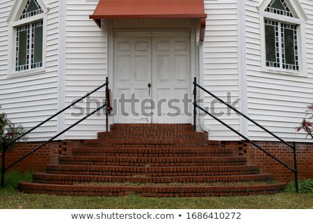 steps to a set of gothic church doors. Stock photo © shanemaritch