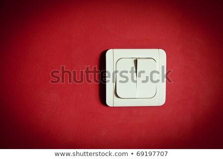 Plastica interruttore della luce rosso muro bianco ufficio Foto d'archivio © vavlt
