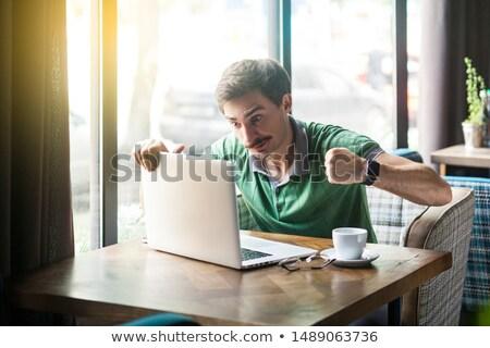 mérges · laptop · számítógép · fiatal · boxoló · üzletember · fehér - stock fotó © lunamarina