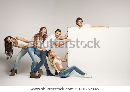 Couple and Board with White Blank Space Stock photo © gromovataya