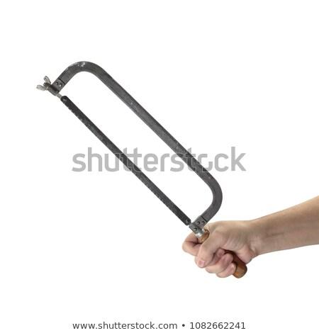 Hand with hacksaw. Stock photo © Kurhan