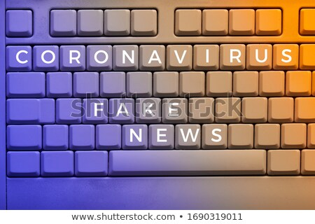 News Concept on Orange Keyboard Button. Stock photo © tashatuvango