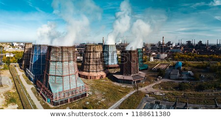 Industrial smokestack with pollution and steam Stock photo © Habman_18