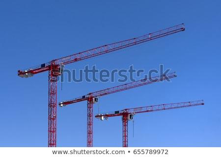 Red crane boom against a blue sky Stock photo © sarahdoow