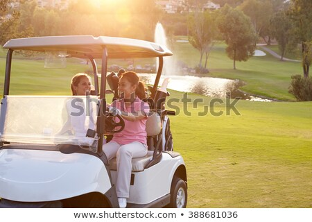 Two Female Golfers Riding In Golf Buggy On Golf Course Stock photo © monkey_business