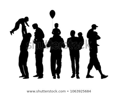 Férfi hordoz fiú vállak család gyermek Stock fotó © bmonteny