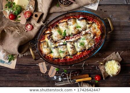 Berenjena relleno queso placa mesa de madera Foto stock © marimorena