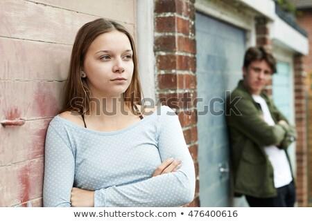 Portrait Of Unhappy Teenage Couple In Urban Setting Stock photo © HighwayStarz
