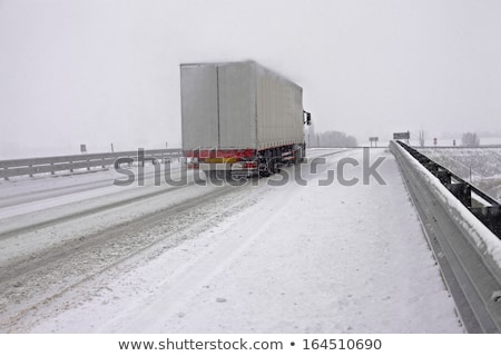 Speeding truck on Snowy road Stock photo © stevanovicigor