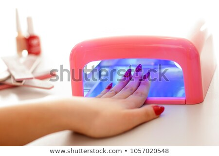 Woman Drying Her Nail Stock photo © AndreyPopov