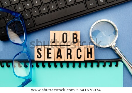 job and magnifier - search sign in blue glass blocks Stock photo © marinini