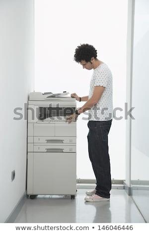 üzletember gép iroda oldalnézet fiatal papír Stock fotó © AndreyPopov