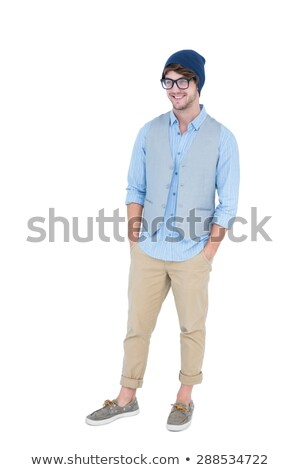 Foto stock: Geeky Hipster With Hands In Pocket