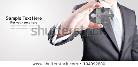 Business word on puzzle in man hands Stock photo © fuzzbones0