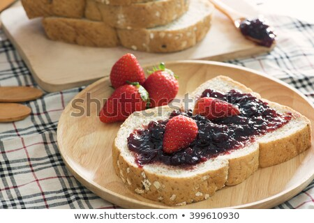 Sliced of whole wheat bread on wooden plate Stock photo © nalinratphi