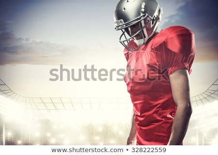 Stock photo: Composite image of american football player looking down