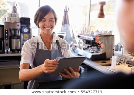 Tablet with cash and credits Stock photo © cherezoff