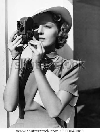 Woman with retro photo camera stock photo © MilanMarkovic78