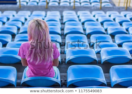 Happy female player looking back at camera Stock photo © deandrobot
