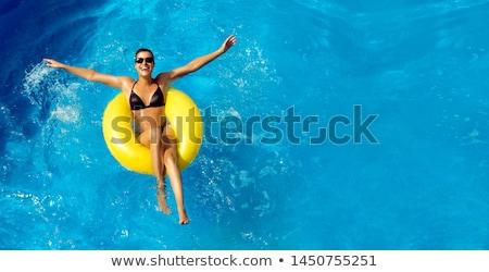 Smiling woman in yellow bikini with copy space Stock photo © dash