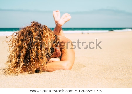 Jumping girl with curly hair stock photo © bezikus