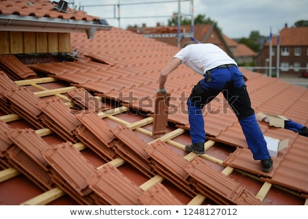 Roofer repair  the roof of clay tiles Stock photo © smuki