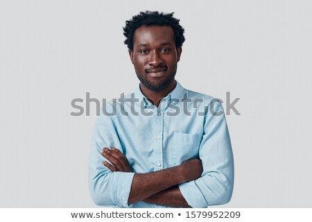 handsome young african man looking at camera stock photo © deandrobot