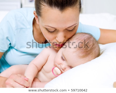 happy young mother near sleeping baby stock photo © o_lypa