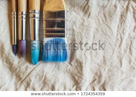 four old used paintbrushes on white background stock photo © manera