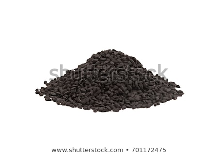 Black cumin seed in wooden scoop isolated on white background. Nigella sativa Stock photo © ivo_13