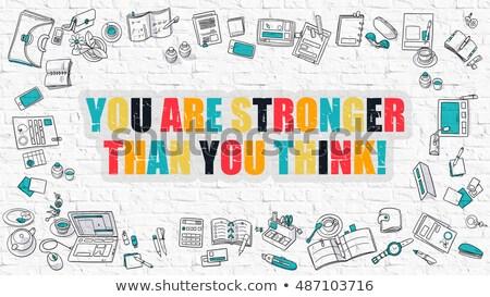 multicolor you are stronger than you think on white brickwall stock photo © tashatuvango
