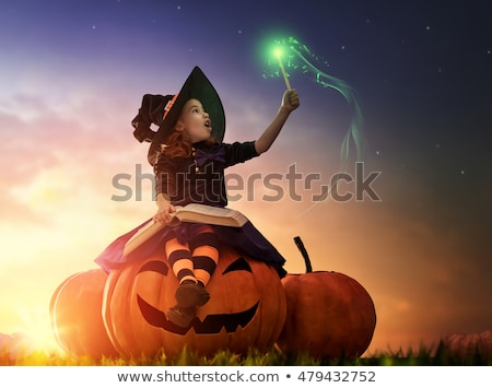 child with book and party stick Stock photo © LightFieldStudios