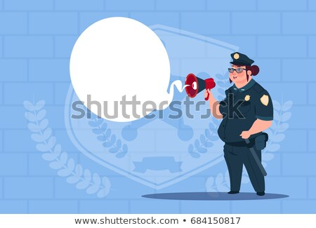 Caucasian policeman speaking into loudspeaker. Stock photo © RAStudio