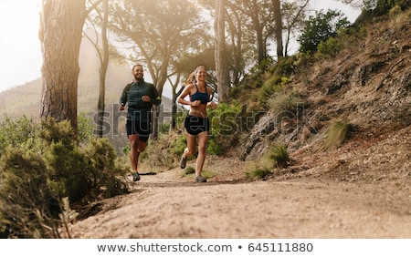 Male running in the hills. Stock photo © IS2
