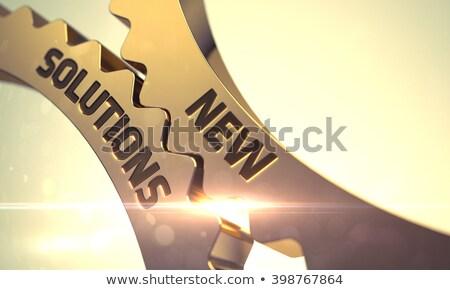Global Solutions Concept. Golden Cogwheels. Stock photo © tashatuvango