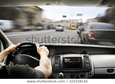 Masculina mano coche volante ciudad tráfico Foto stock © stevanovicigor